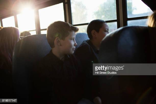 Students sitting on school bus