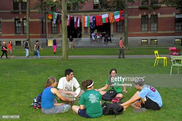 Students sitting on the grass at Harvard Yard.