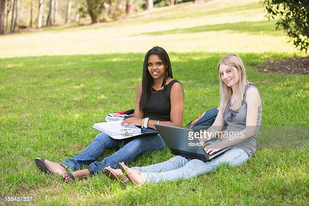 Students Sitting on the Grass Studying