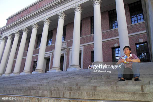 Students sitting on the steps of Widener Library