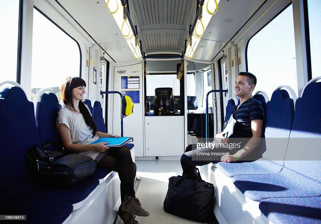 students sitting opposite tram : Stock Photo