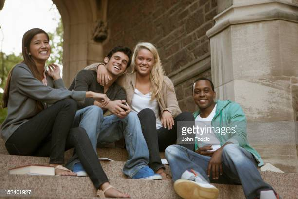 Students sitting together on campus steps