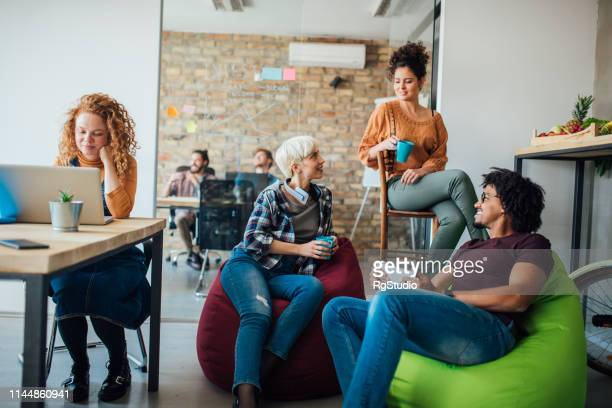 students smiling and drinking coffee while studying - students' union stock pictures, royalty-free photos & images