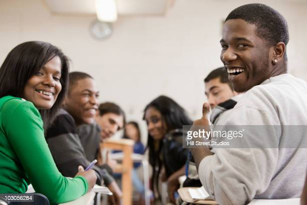 students smiling in classroom - gardena california stock pictures, royalty-free photos & images