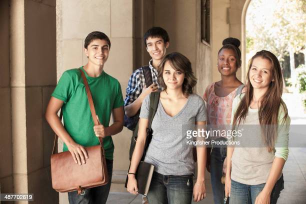 students smiling together on campus - multiculturalism stock pictures, royalty-free photos & images