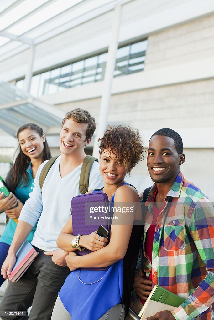 Students smiling together outdoors : Stock Photo