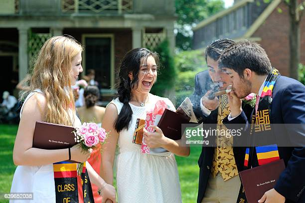 students smoking on commencement day - boarding school stock photos and pictures