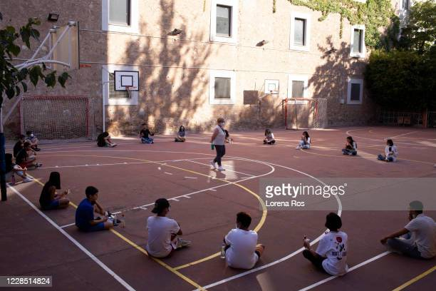 Students social distance outside during the first day of school at Vedruna Angels School in Raval neighborhood on September 14, 2020 in Barcelona,...