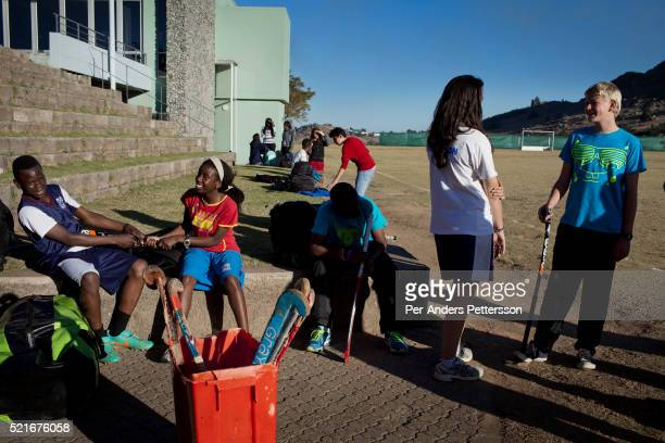Students socialize before a hockey practice at Waterford Kamhlaba United World College of Southern Africa, a secondary school on August 1, 2013 in...