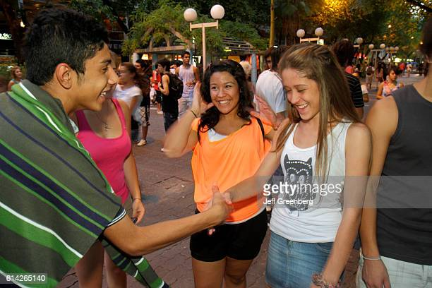 Students socializing in Paseo Sarmiento