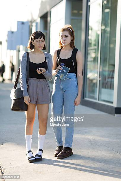 Students Sofia Parkerson and Cassidy Little wear an American Apparel shirt and thrifted outfits on December 3 2014 in Miami Beach Florida