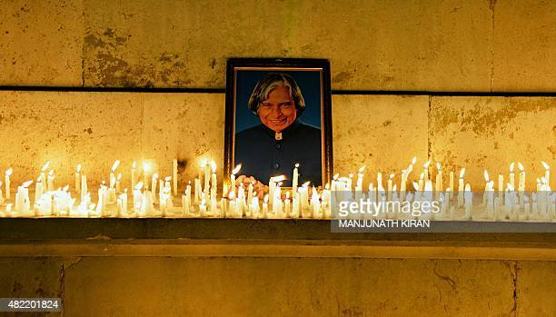 Students staff and members of the faculty of the Indian Institute of Science pay a candle light tribute to former Indian president APJ Abdul Kalam in...
