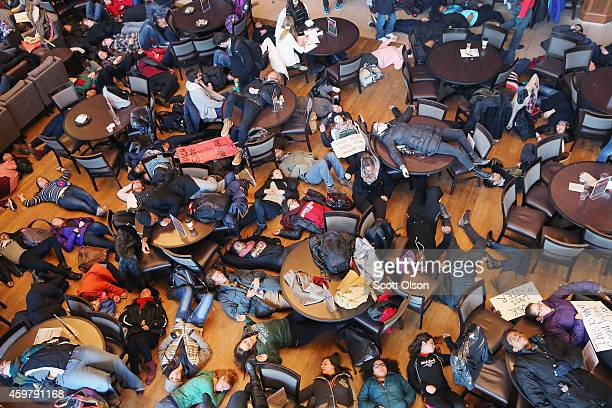 Students stage a 'die in' at Washington University to draw attention to police abuse on December 1 2014 in St Louis Missouri The 'die in' was part a...