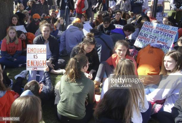 Students stage a sitdown in Lafayette Square across the White House in Washington DC on April 20 2018 to protest gun violence Students across the US...