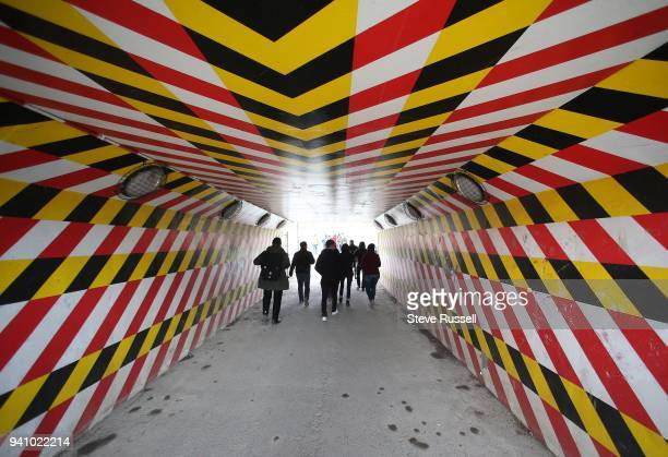 TORONTO ON MARCH 9 Students stand in an underpass under railway tracks as the look Eastwards to their study area as they check out the area for the...
