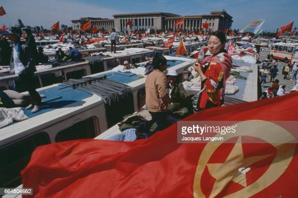 Students stand on top of busses during a hunger strike in Beijing's Tiananmen Square In the spring of 1989 students and citizens held massive...