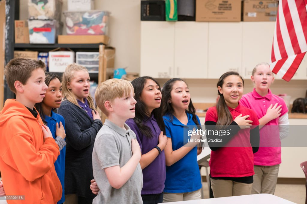 Students standing for Pledge of Allegiance : Stock Photo