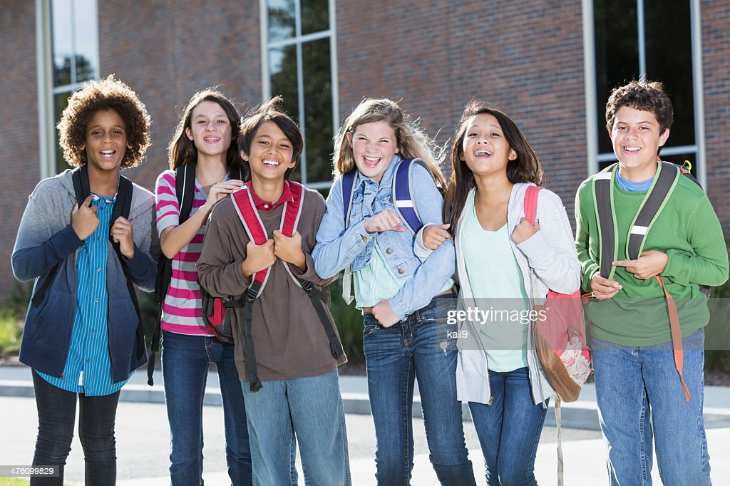 Students standing outside building : Stock Photo