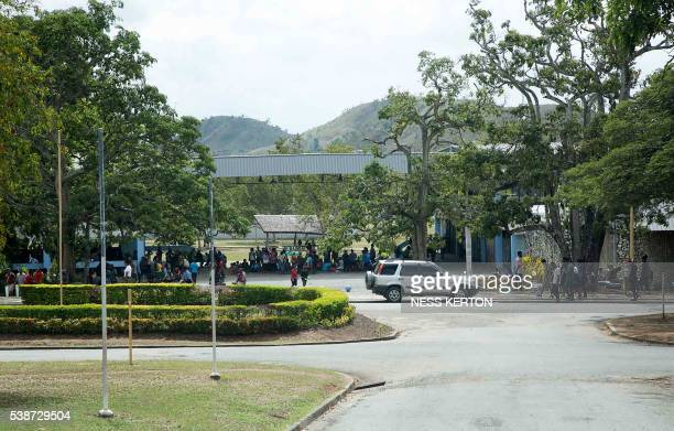 Students stay in the main campus gathering area of the University of Papua New Guinea following a protest rally by the students in Port Moresby on...