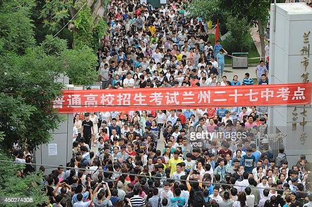 Students step out of the examine room after the first subject of the National College Entrance Examination at Lanzhou NO27 High School on June 7 2014...