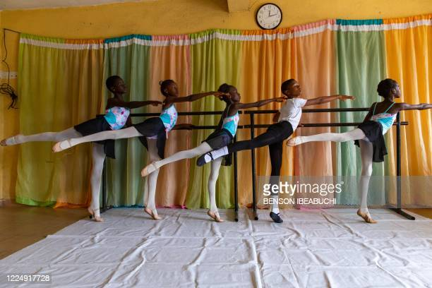Students stretch during rehearsals at the Leap of Dance Academy in Ajangbadi, Lagos, on July 3, 2020. - The Leap of Dance Academy is a ballet school...