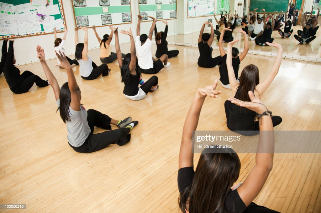 Students stretching in dance class : Stock Photo