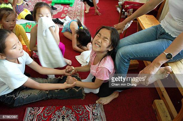 Students stretching their legs at the contortionist school in the Mongolian Circus July 20 2005 in Ulaanbaatar Mongolia