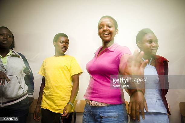 Students study and fraternize inside the girls dorm after school at the Agahozo Shalom Youth Village on March 12 2009 in Rwamagana Rwanda The ASYV...
