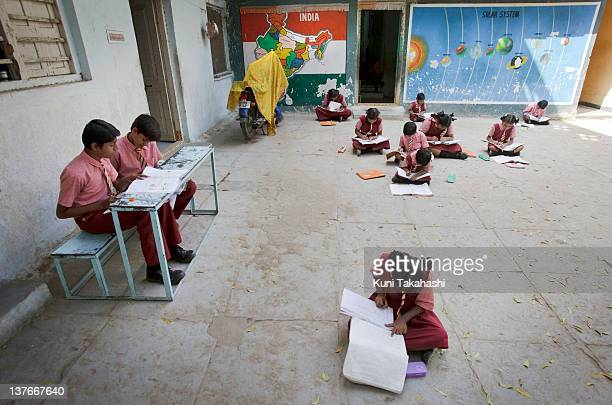 Students study at Bhareti School on November 24, 2011 in Hyderabad, India. The school was shut down in September for a day due to lack of official...