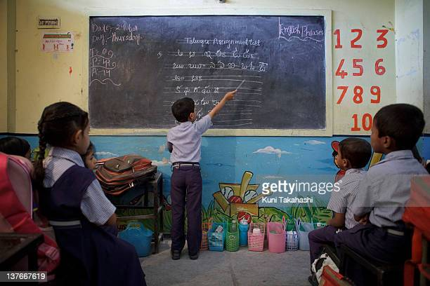 Students study at M.A. Idial High School, a private school, on November 24, 2011 in Hyderabad, India. The government's recent passage of the Right to...
