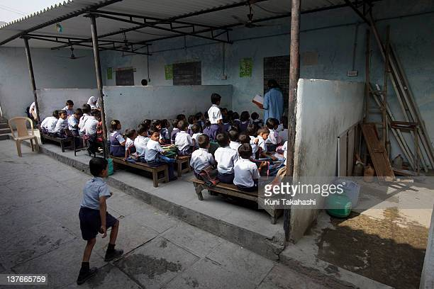 Students study at M.A. Idial School, a private school, on November 25, 2011 in Hyderabad, India. The government's recent passage of the Right to...