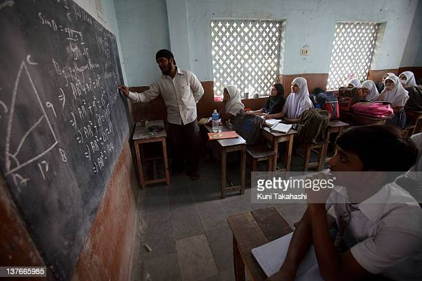 Students study at the Holy Town High School a private school on November 24 2011 in Hyderabad India The government's recent passage of the Right to...