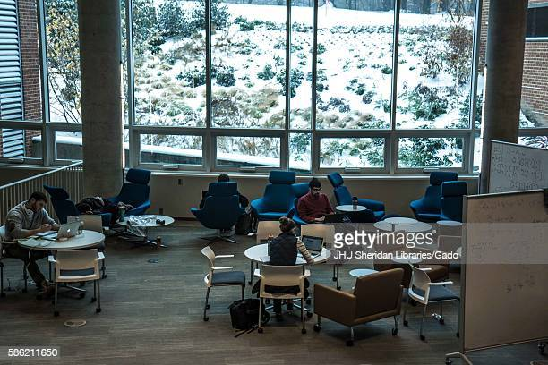 Students study in the Brody Learning commons an interactive/collaborative study space and library while it is a snow day on the Homewood campus of...