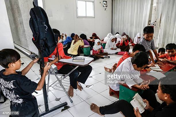 Students study in the classroom at MASTER School on February 20 2014 in Depok West Java Indonesia The school is known as Masjid Terminal school or...