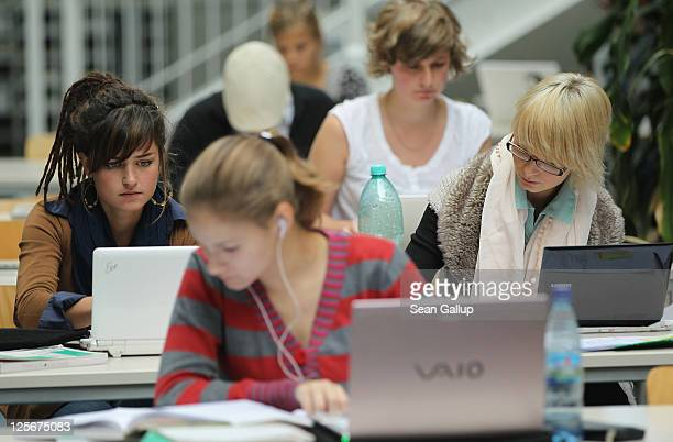 Students study with their laptop computers in the Pedagogical Library at the Freie Universitaet university on September 20 2011 in Berlin Germany...