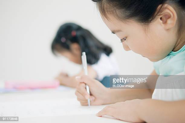 Students studying at desks in classroom