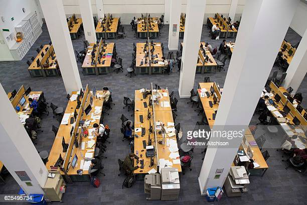 Students studying at hot desks inside the main LSE library designed by Norman Foster The London School of Economics and Political Science Westminster...