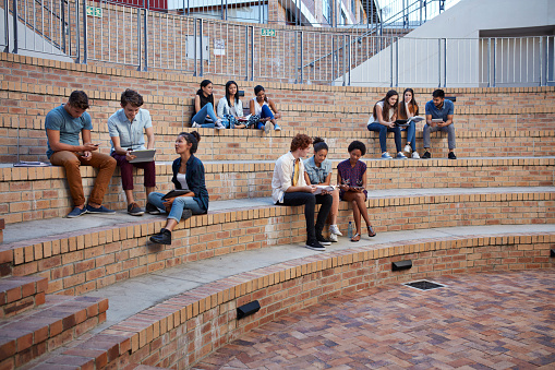 Students studying in groups outside - gettyimageskorea