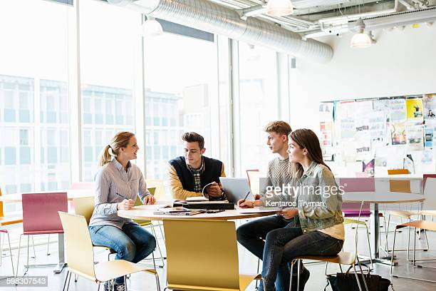 Students studying in university classroom