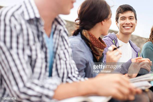 students studying together outdoors - peterborough ontario stock photos and pictures