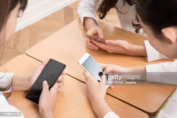 students studying with digital tablet in classroom - corée du sud photos et images de collection