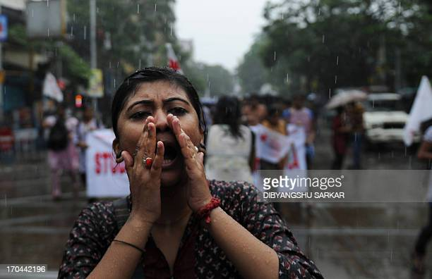 Students supporting various Leftist parties shout antigovernment slogans during a protest following the recent gangrape and murder of a 20yearold...