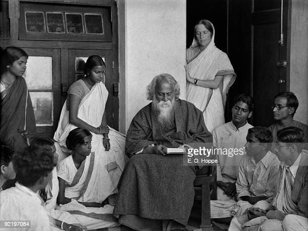 Students surround writer Rabindranath Tagore at his university Visva Bharati in Santineketan West Bengal India 1929
