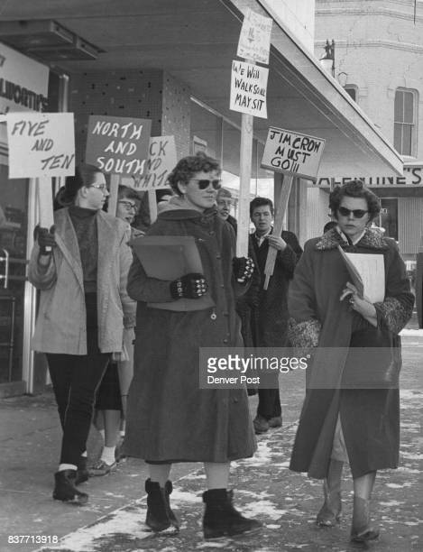 Students Sympathize Woman passing by ignores a group of the 34 University of Colorado students who picketed Woolworth and S H Kress Co stores in...