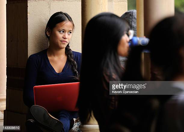 Students take a break at Royce Hall on the campus of UCLA on April 23 2012 in Los Angeles California According to reports half of recent college...