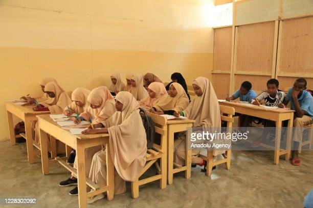 Students take a class as schools begin in the Somalian capital Mogadishu on September 01 2020 amid the coronavirus pandemic