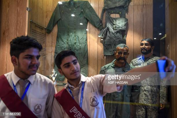 Students take a selfie in front of the statue of Indian pilot Wing Commander Abhinandan Varthaman whose plane was shot down over Kashmir earlier this...