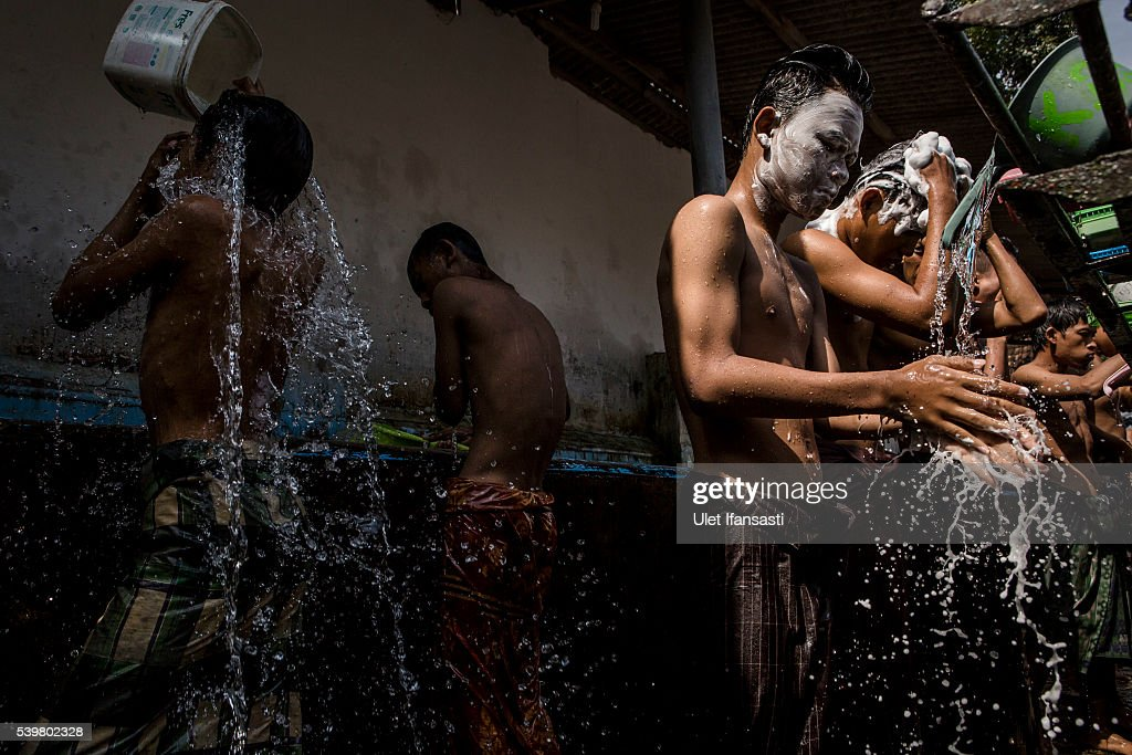 Students take a shower at the islamic boarding school Lirboyo during the holy month of Ramadan on June 10, 2016 in Kediri, East Java, Indonesia. The Islamic boarding school, Lirboyo, was founded by KH Abdul Karim in 1910, and known to be one of the largest traditional 'Pesantren' in Indonesia, with around 17,000 students in Kediri, East Java. Students at the Pesantren, also known as 'Santri', are separated from their families and spend their days studying Islamic scriptures, reading the Quran and learning Arabic in addition to other activities which begins with the morning prayer at 4am till midnight.