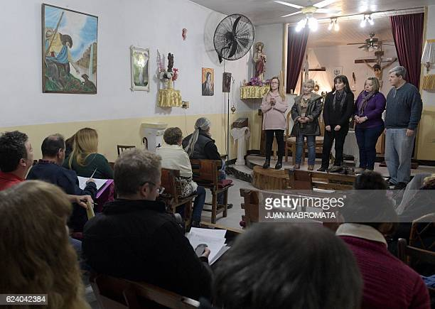 Students take an oral exam at the 'El Buen Pastor' parish in Santos Lugares outskirts of Buenos Aires on September 6 2016 Acuna who defines himself...