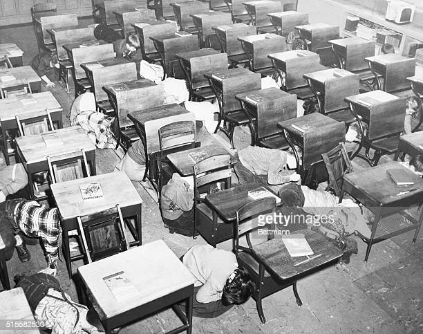 Students take cover during an air raid drill in St Mary's Berea